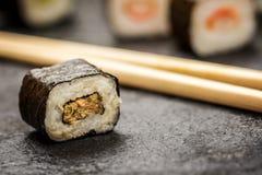 Sushi rolls hosomaki. Traditional japanese sushi rolls hosomaki and chopsticks on stone desk Stock Image