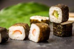 Sushi rolls hosomaki. Traditional japanese sushi rolls hosomaki on stone desk Stock Images