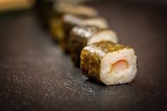 Sushi rolls hosomaki. Traditional japanese sushi rolls hosomaki on stone desk Stock Image