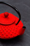 Traditional Japanese teapot on slate. Traditional Japanese red teapot on black slate Stock Image