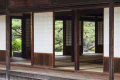 Traditional Japanese Tearoom in Formal Garden. A traditional ceremonial tearoom in a Japanese garden. The wooden building has tatami mats, sliding paper screen Stock Photo