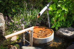 Traditional japanese water fountain in garden Stock Photo