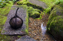 Traditional japanese weight in zen garden Stock Photography