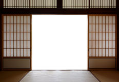 Traditional Japanese wood and rice paper doors and tatami mat flooring royalty free stock photos