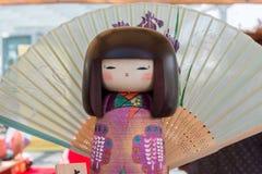 Traditional Japanese Wooden Kokeshi Doll and wagasa umbrella in stock photo