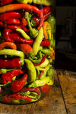 Traditional Jarred yellow, green, red, hot peppers. High resolution image Royalty Free Stock Image