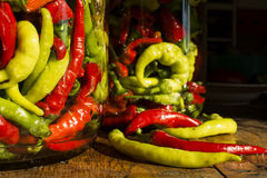 Traditional Jarred yellow, green, red, hot peppers. Royalty Free Stock Images