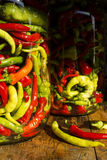 Traditional Jarred yellow, green, red, hot peppers. High resolution image Stock Photos