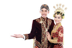 Traditional java wedding couple husband and wife presenting blan Stock Photos