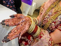 Traditional jewelry, henna and dress. Of just married east Indian woman stock image