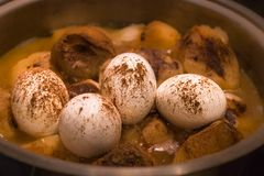 Traditional Jewish Cholent hamin. Traditional Jewish coolant prepared for Shabbat meal made with beef, potatoes and eggs royalty free stock photos