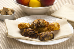 Traditional Jewish Dessert  Rugelach. The traditional Jewish dessert rugelach on table with sugar cubes and fruit Royalty Free Stock Photo