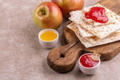 Traditional Jewish kosher matzo with apples, jam and honey stock image