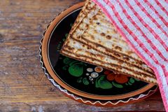 Traditional Jewish kosher matzo for Passover macro. On a wooden table Stock Photos