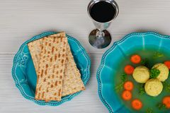Traditional Jewish passover dish matzah ball soup served with. Matzah, Jewish symbols for the Passover Pesach holiday Stock Photo