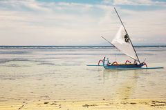 Traditional Jukung boat on water Stock Photo