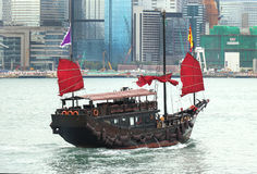 Traditional junk boat. Junk is a type of ancient Chinese sailing ship that is still in use today in Hong Kong as tourist attraction Royalty Free Stock Photography