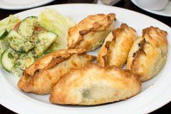 Traditional Karaite pasty (Kibin). Traditional Karaite pasty stuffed with meat. Picture taken in Lithuanian restaurant in Gdansk, Poland Stock Images