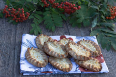 Traditional Karelian pasties on rustic wooden background Stock Image