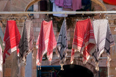Traditional keffiyehs hanging on hangers. Royalty Free Stock Images