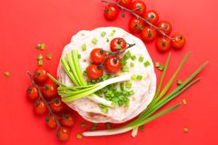 Indian flatbread chapati, green onion, cherry tomato. Color surge trend. Traditional Kerala Indian cuisine. Homemade flatbread chapati with green onion and royalty free stock images
