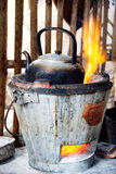 Traditional kettle. Antique kettle on the hot stove stock image