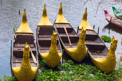 Traditional khmer boats with carved bows Stock Image