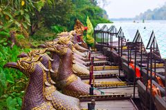Traditional khmer boats with carved bows Royalty Free Stock Photography
