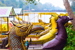 Traditional khmer boats with carved bows Stock Photos