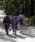 Traditional kimono. A man and two women  walking through Kyoto,wearing traditional summer light kimono Stock Photography