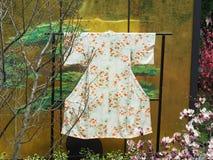 Traditional Kimono. A traditional kimono on a display stand Stock Photo