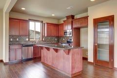 Traditional kitchen with dark hardwood floor. Royalty Free Stock Photos