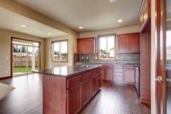 Traditional kitchen with dark hardwood floor. Stock Photos