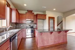 Traditional kitchen with dark hardwood floor. Royalty Free Stock Photography
