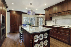 Traditional kitchen with granite island Stock Images