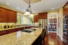 Traditional kitchen with nice counters and dark hardwood floor. Traditional kitchen with dark hardwood floor, and nice marble counters Royalty Free Stock Images
