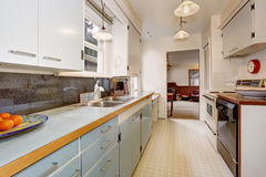 Traditional kitchen with tile floor, in boho chic house. Royalty Free Stock Images