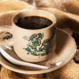 Traditional kopitiam style Chinese coffee in vintage mug Stock Images