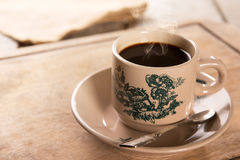 Traditional kopitiam style Nanyang coffee in vintage mug Stock Photo