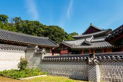 Traditional korean architecture with castle wall. Under clear blue sky Royalty Free Stock Photography
