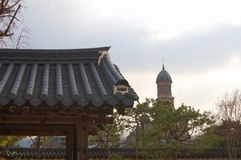 Traditional korean Buildings and trees with a catholic christan church on one picture. stock photography