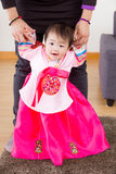 Traditional korean costume baby learn to walk Stock Image