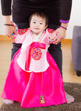Traditional korean costume baby try to stand up Royalty Free Stock Photo