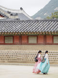 Traditional Korean Dress. It is very popular for tourists and locals alike to dress up in traditional Korean dress for a photo op while visiting South Korea`s Royalty Free Stock Photo