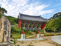 Traditional korean gate with big stone in garden Royalty Free Stock Image