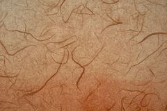 Dark orange colored Korean or Japanese traditional paper. royalty free stock photo