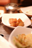 A traditional Korean restaurant with various side dishes. Korean meal side dishes of vegetable kinchi groundnuts garlic bean sprou Stock Photography