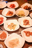 A traditional Korean restaurant with various side dishes. Korean meal side dishes of vegetable kinchi groundnuts garlic bean sprou Royalty Free Stock Photo