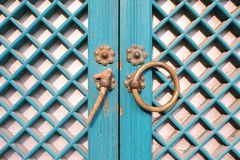 Traditional Korean wooden doors with ring handle. Traditional Korean wooden doors with metal ring latch/handle and lattice design Royalty Free Stock Photo