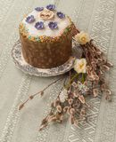 Kulich and willow twigs. Traditional Kulich with   icing and willow twigs. Palm Sunday Stock Image